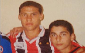 Hernanes et le petit Heno, à Sao Paulo.